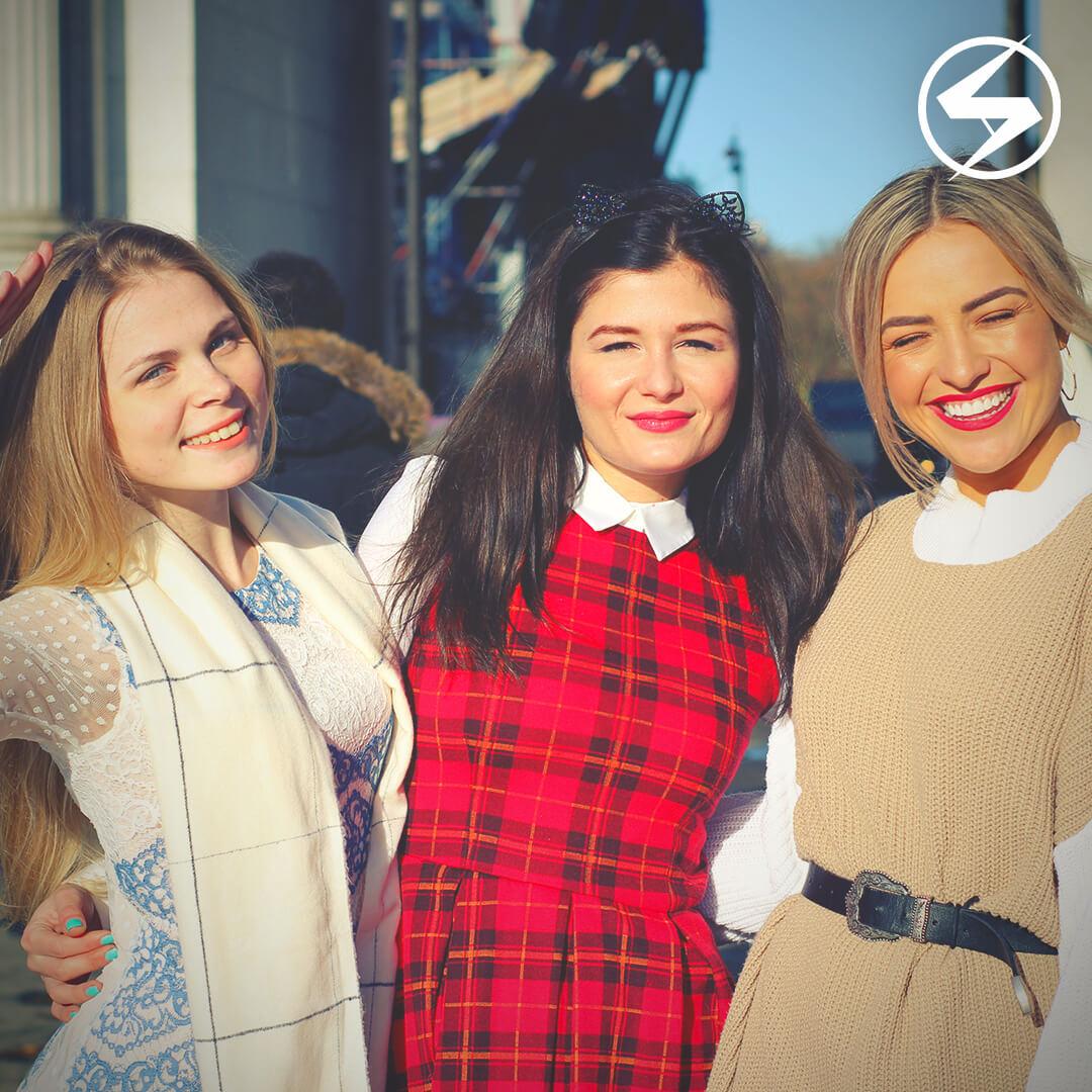 3 models smiling at the camera